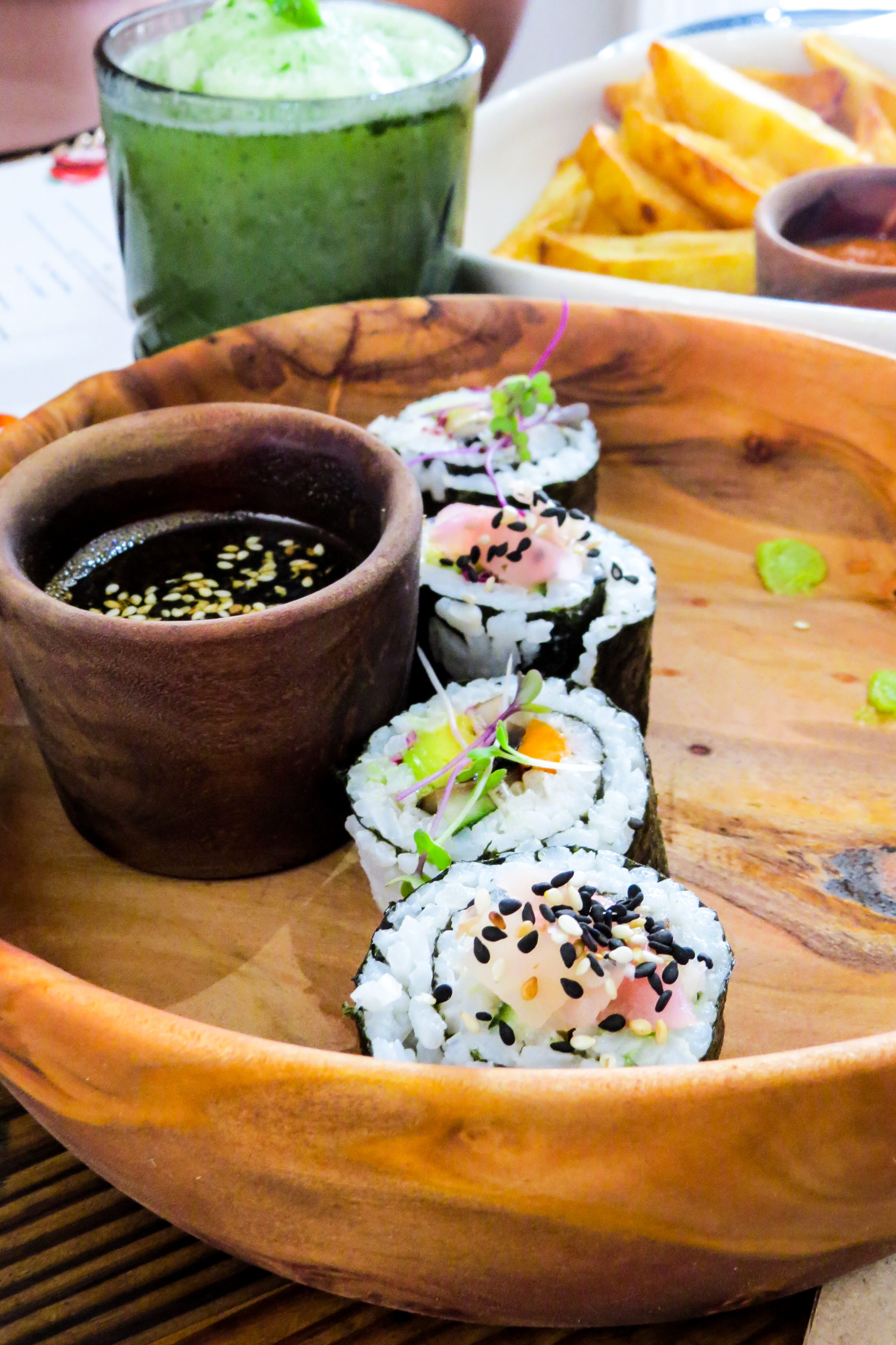 wooden bowl with sushi and soy sauce