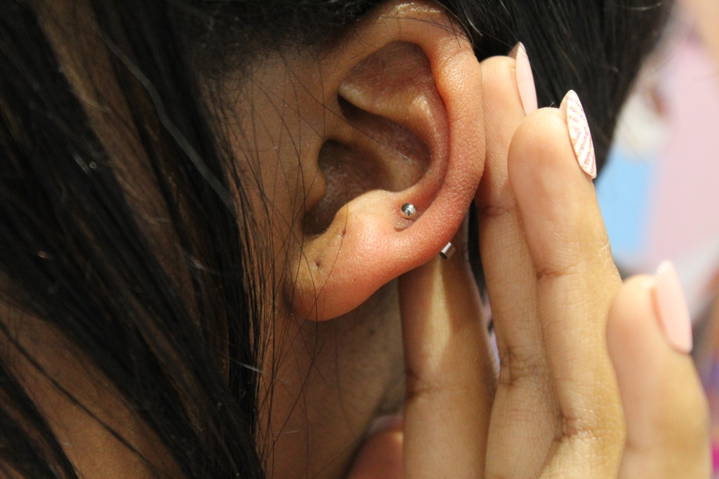 getting an ear piercing at Claire's