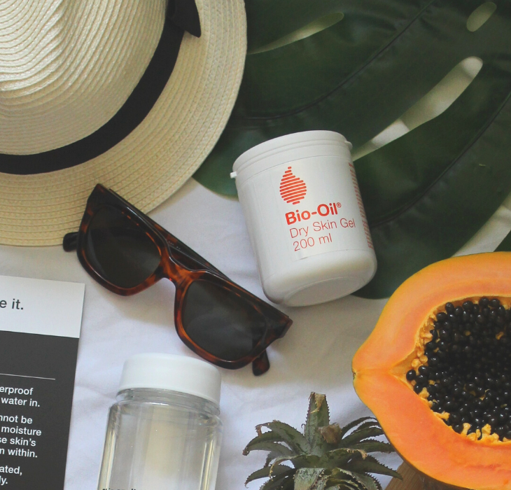 body product with sunglasses and papaya