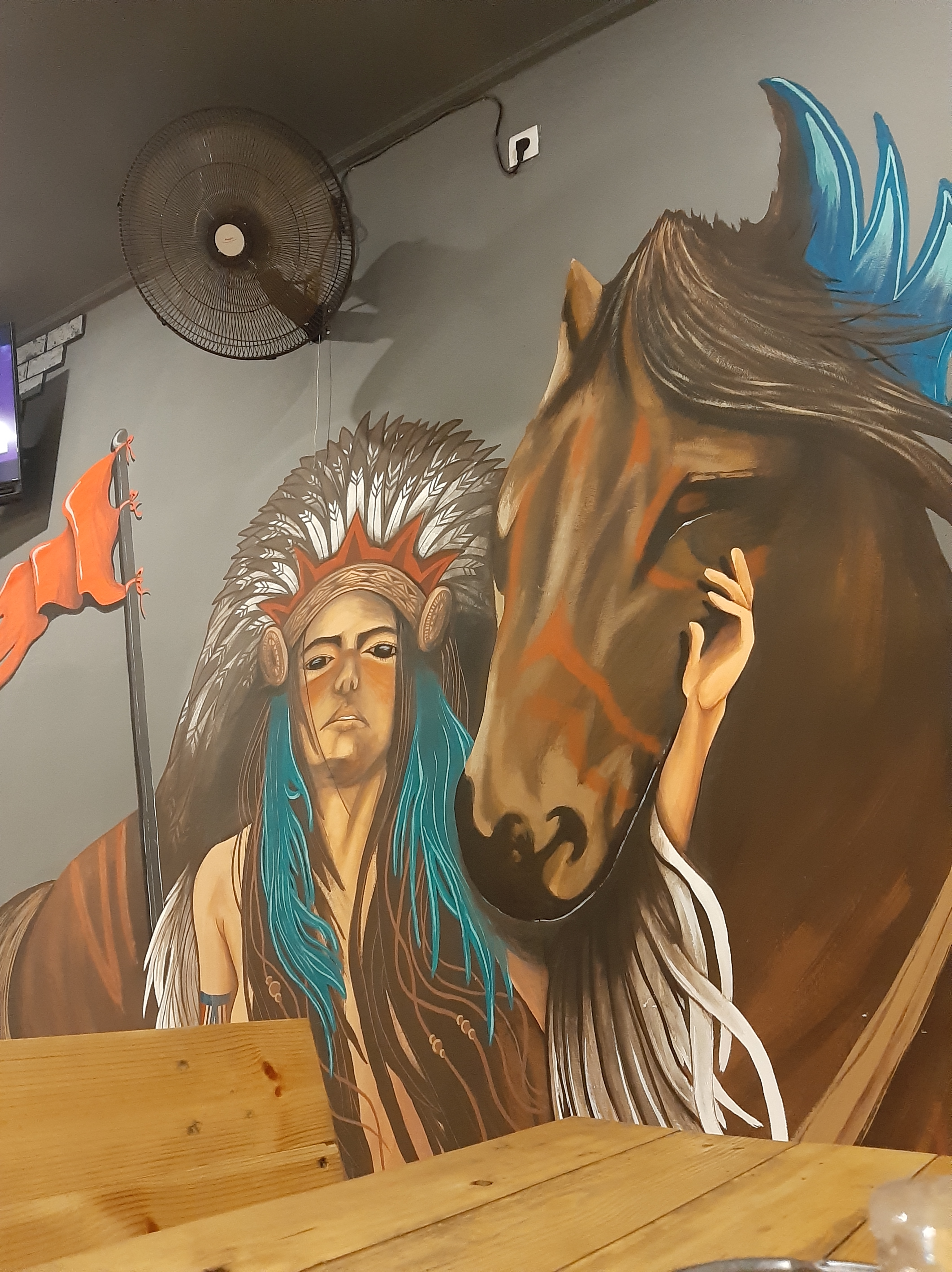 art mural of red indian and horse on the wall