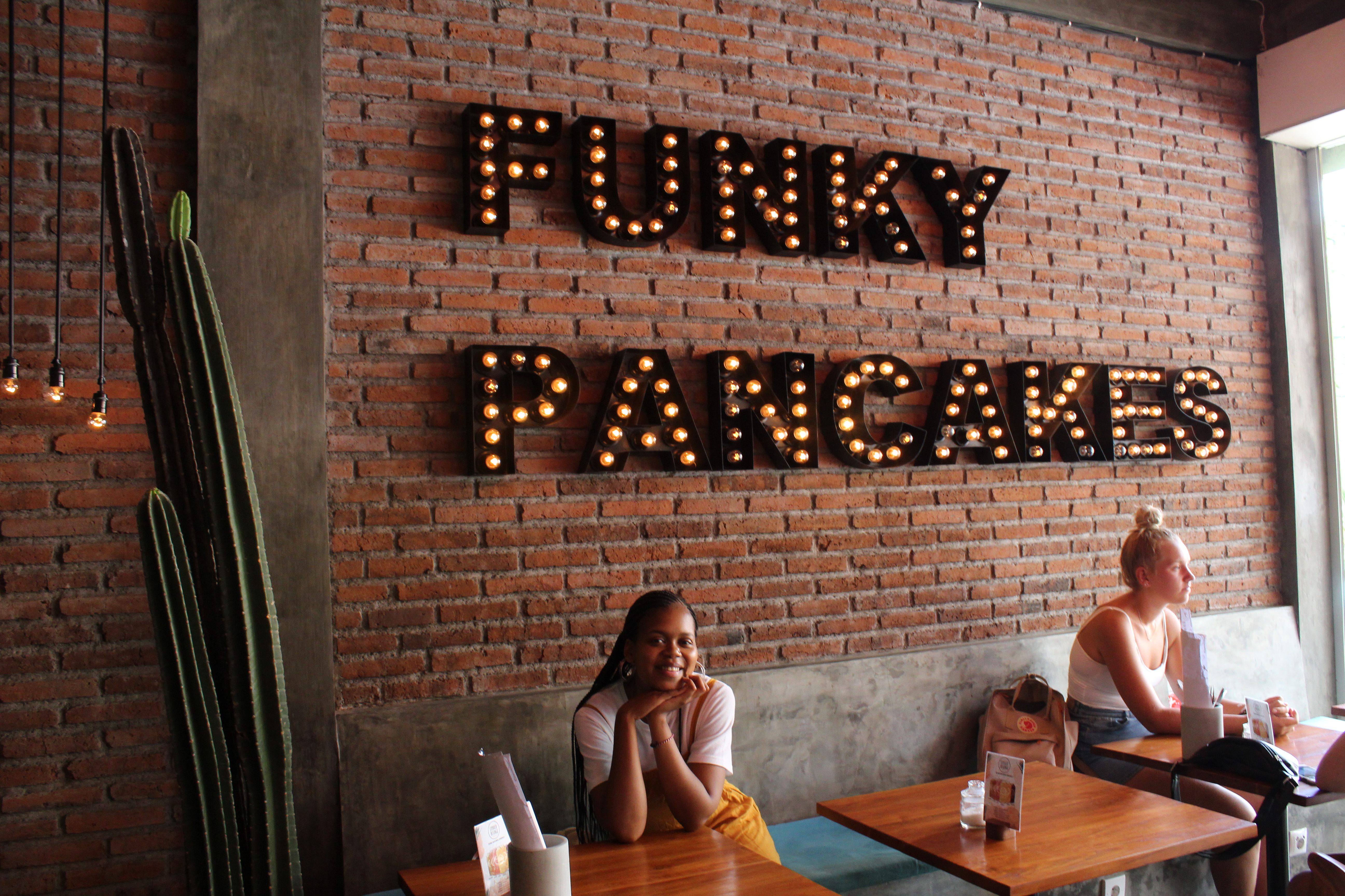 funky pancakes letters on brick wall in canguu