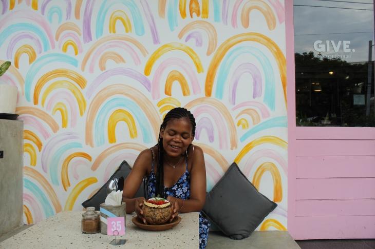 khalipha ntloko eating smoothie bowl at give cafe in canguu bali