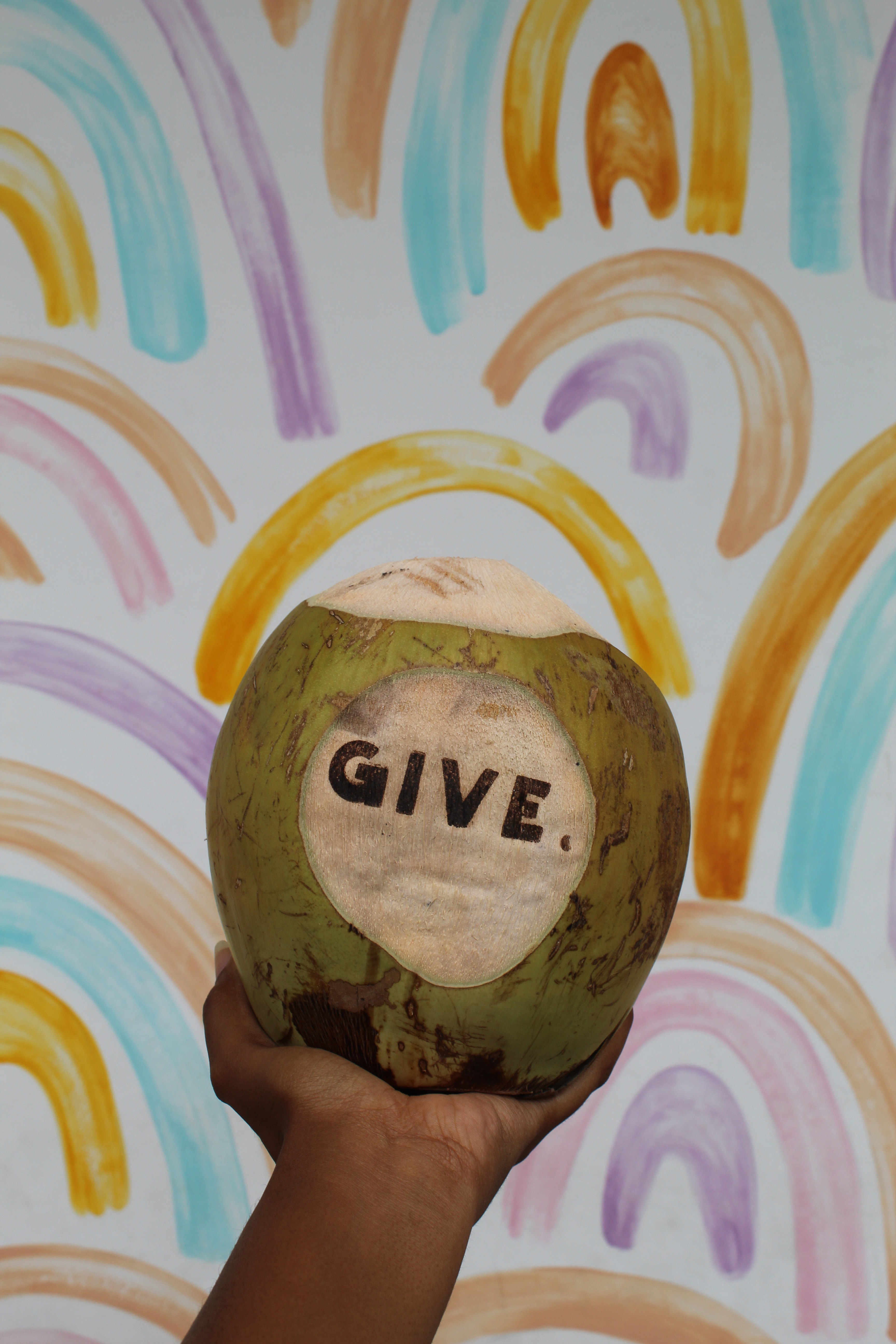 photo of coconut in hand at give cafe in canguu bali