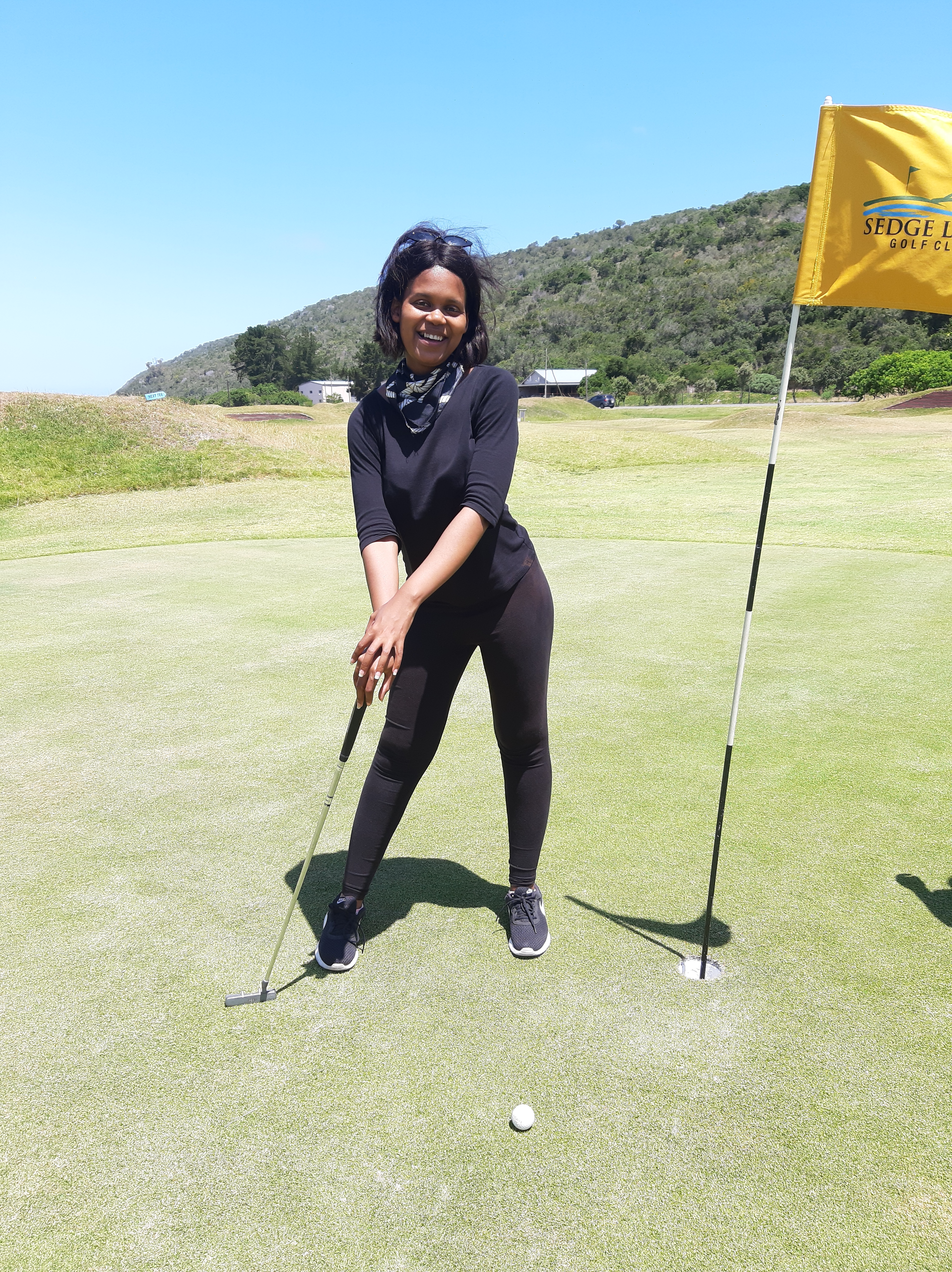 khalipha ntloko in black clothing playing golf at sedge links in western cape