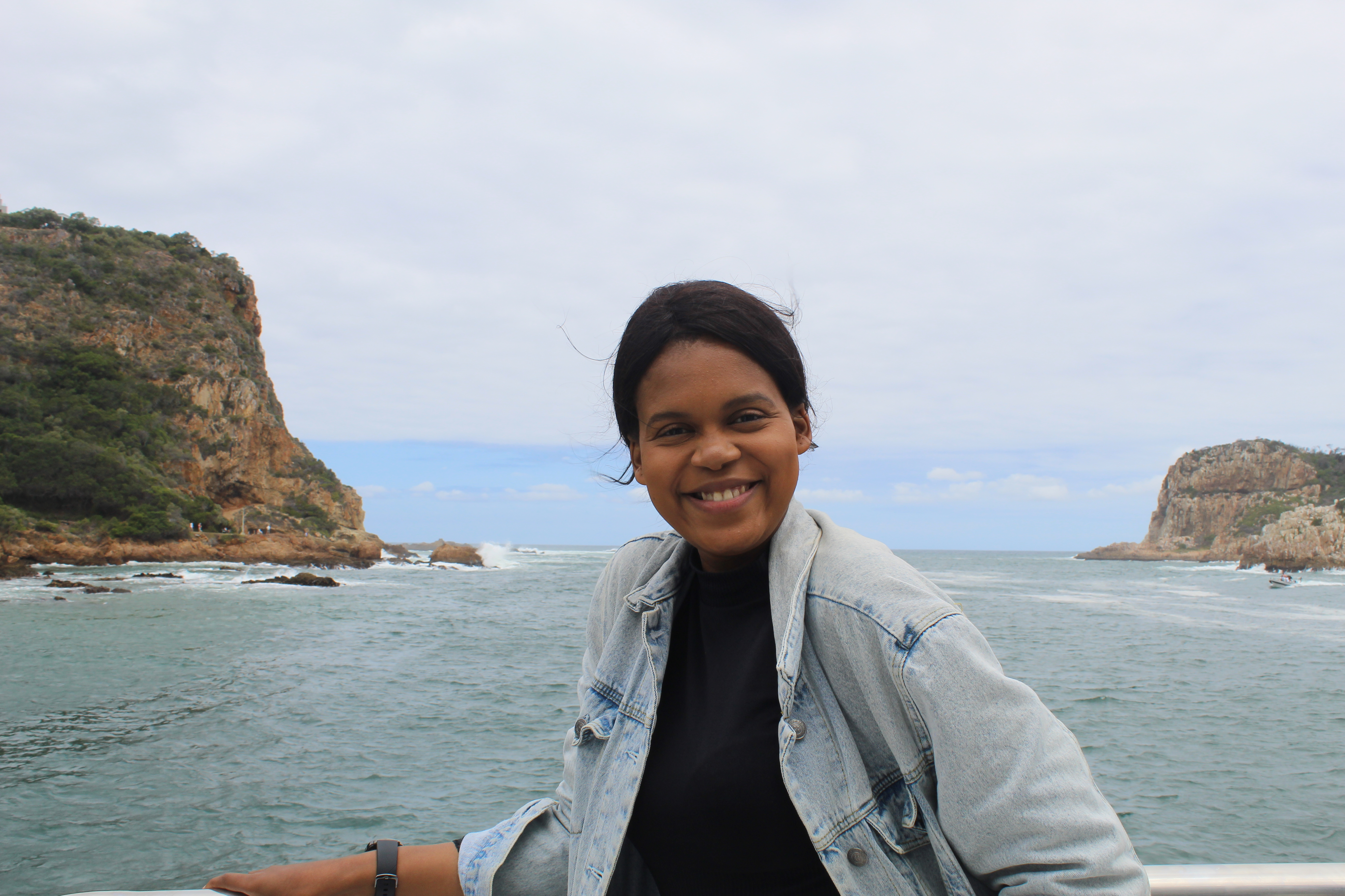 girl smiling at knysna heads