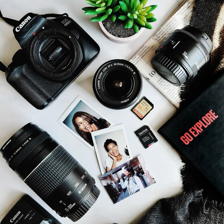 camera flatlay photo with canon 400D and SD cards and instax photos of khalipha ntloko