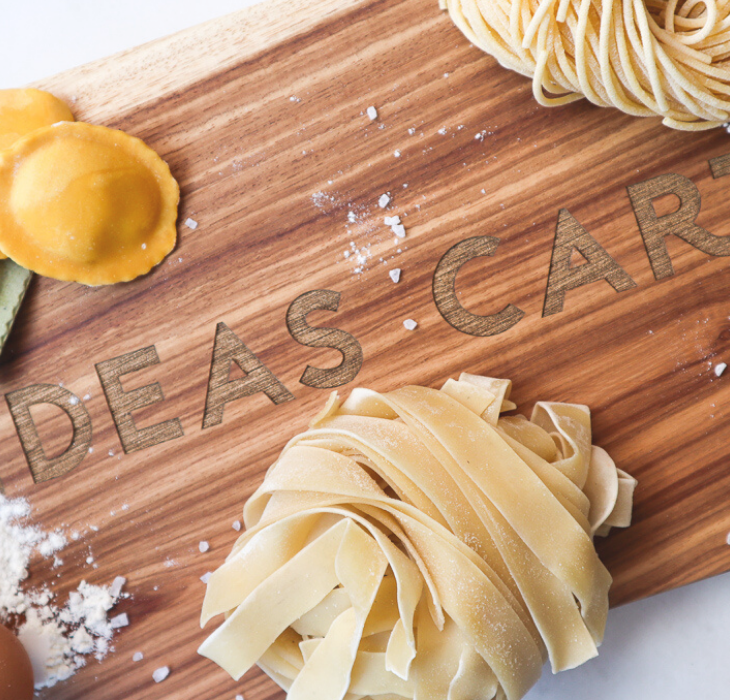 ideas cartel cape town on wooden chopping board with pasta and salt