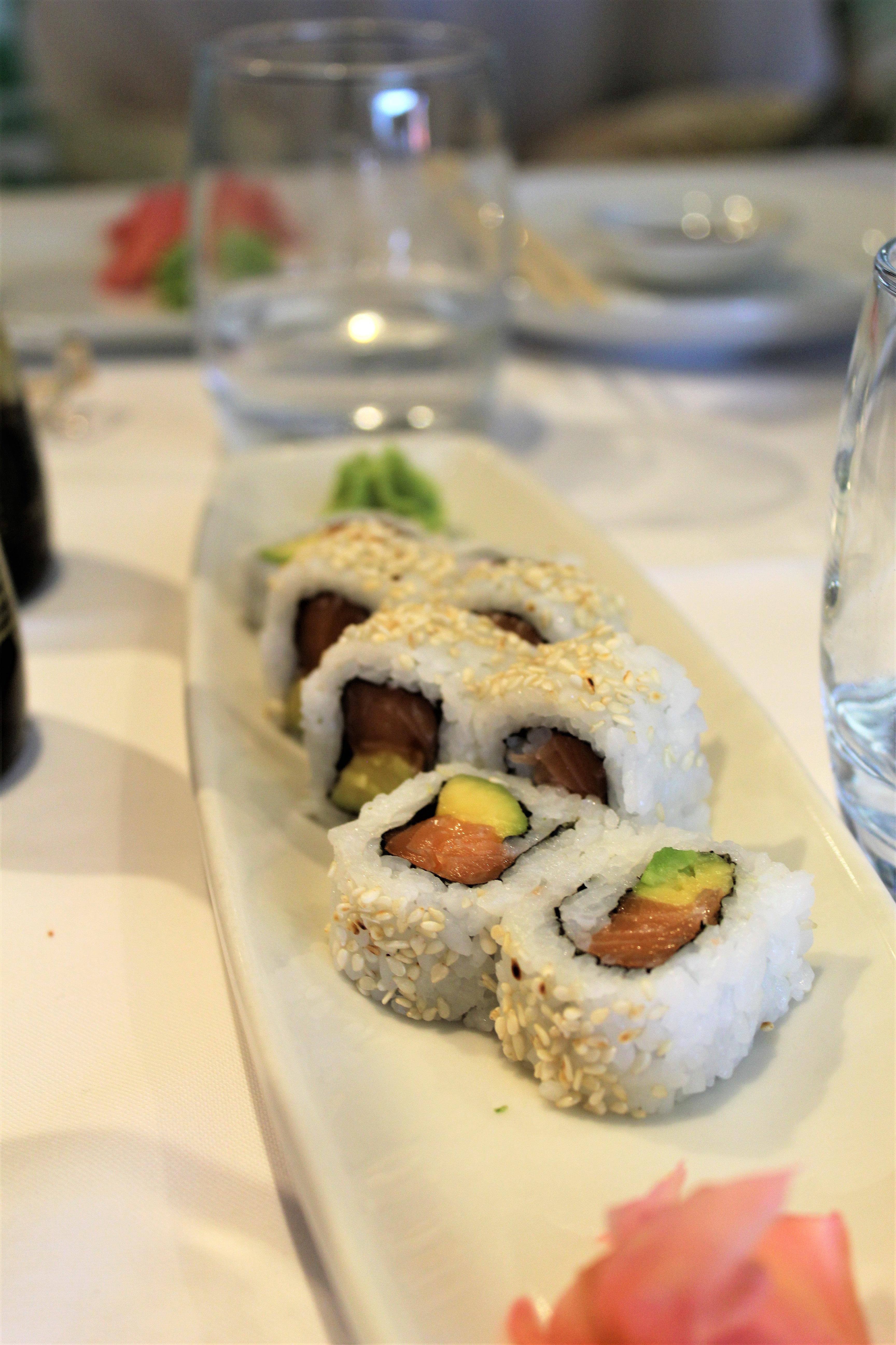 California rolls and sushi on white plate