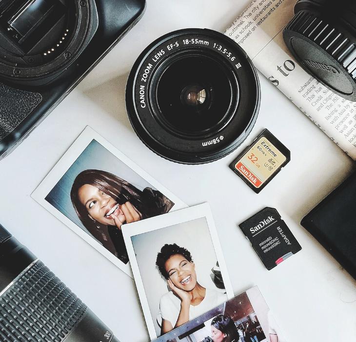 flatlay photo of canon camera and polaroid