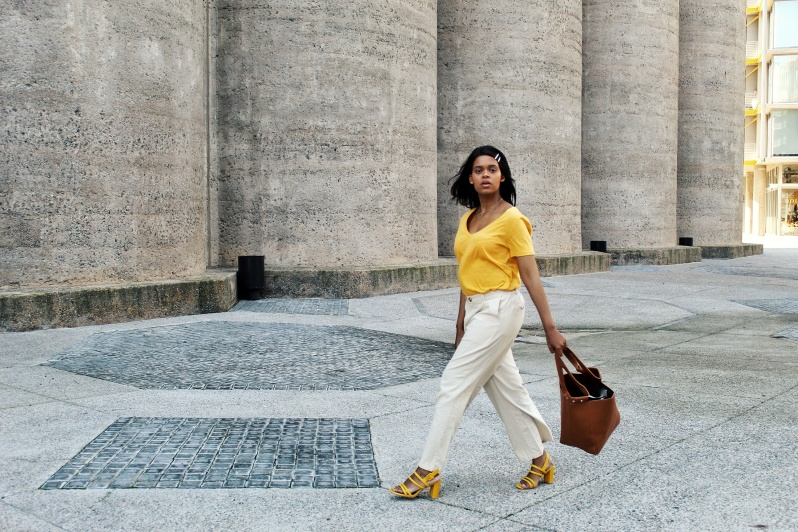 girl in yellow top with brown handbag for fashion